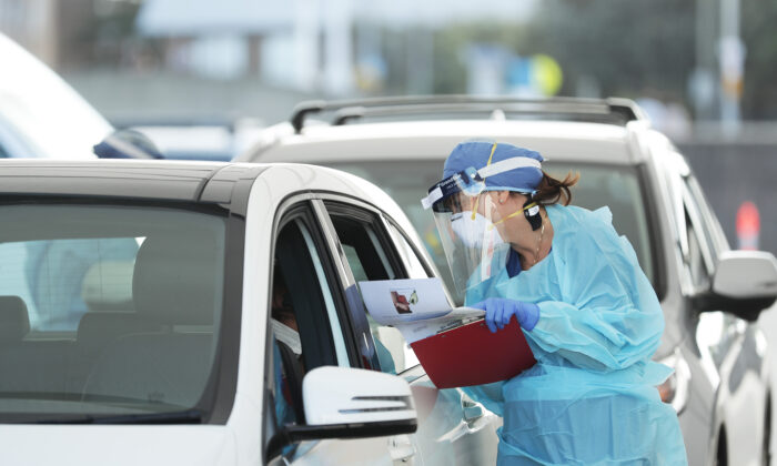 Medical professionals administer COVID-19 tests at the Bondi Beach drive-through COVID-19 testing center on April 6, 2020 in Sydney, Australia. (Mark Metcalfe/Getty Images)
