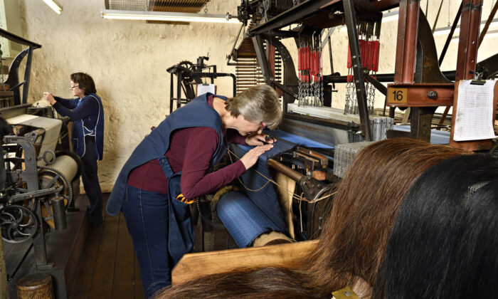 For nearly 150 years, the manufacturing process at John Boyd Textiles Ltd. has remained the same, although the unique looms, patented in 1872, are now powered by electricity. (Rob Scott/John Boyd Textiles Ltd.)