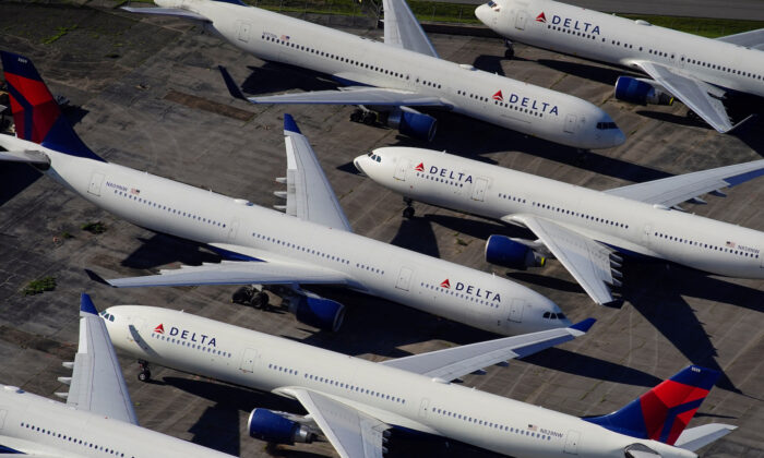 Delta Air Lines passenger planes are seen parked due to flight reductions made to slow the spread of COVID-19, at Birmingham-Shuttlesworth International Airport in Birmingham, Ala., on March 25, 2020. (Elijah Nouvelage/Reuters)