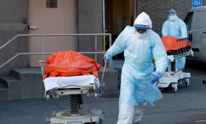 Healthcare workers wheel the bodies of deceased people from the Wyckoff Heights Medical Center during the outbreak of COVID-19 in New York City, New York, on April 4, 2020. (Andrew Kelly/Reuters)