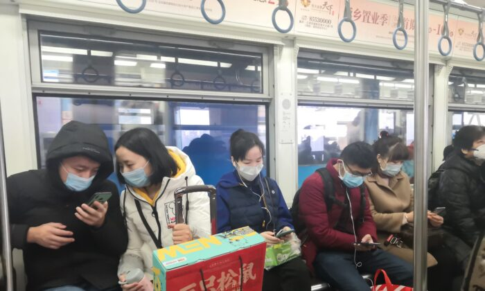 Wearing a mask is especially advised for crowded places like buses and subway cars. (helloabc/Shutterstock)