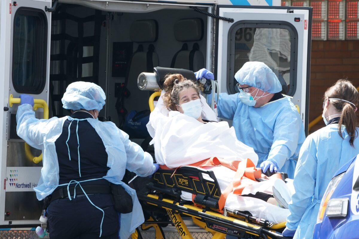 A woman arrives by ambulance