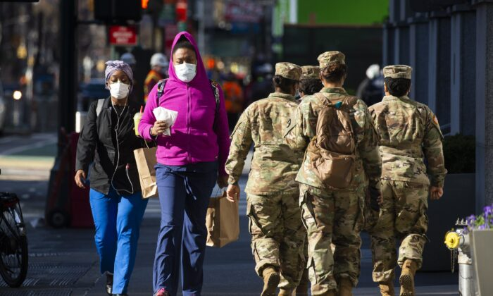 People wear masks as they walk in Midtown Manhattan, New York City on April 6, 2020. (Kena Betancur/Getty Images)