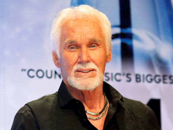 Kenny Rogers poses backstage after accepting the Willie Nelson Lifetime Achievement award