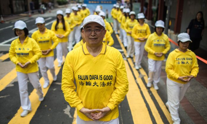 Supporters of the Falun Gong spiritual practice take part in a march in Hong Kong on April 27, 2019. (DALE DE LA REY/AFP via Getty Images)
