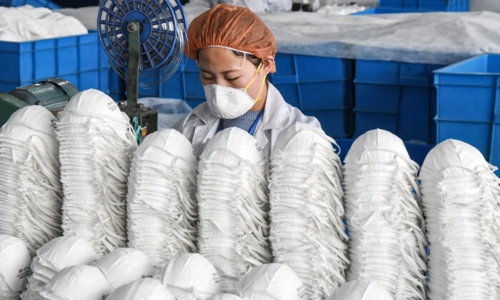 A worker producing protective masks at a factory in Handan city, Hebei province, China, on Feb. 28, 2020. (Str/AFP via Getty Images)