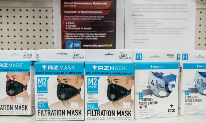 Signs detailing the Center for Disease Control's  advice for combatting Coronavirus are displayed above facemasks at a Manhattan hardware store in New York City on Feb. 26, 2020 in New York City. (Scott Heins/Getty Images)