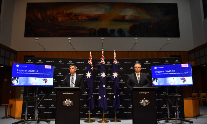 Prime Minister Scott Morrison (R) and Chief Medical Officer Brendan Murphy during a press conference in the Main Committee Room at Parliament House in Canberra, Australia, on April 07, 2020.  (Sam Mooy/Getty Images)