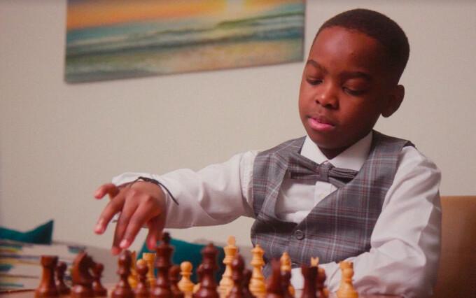tani adewumi plays chess