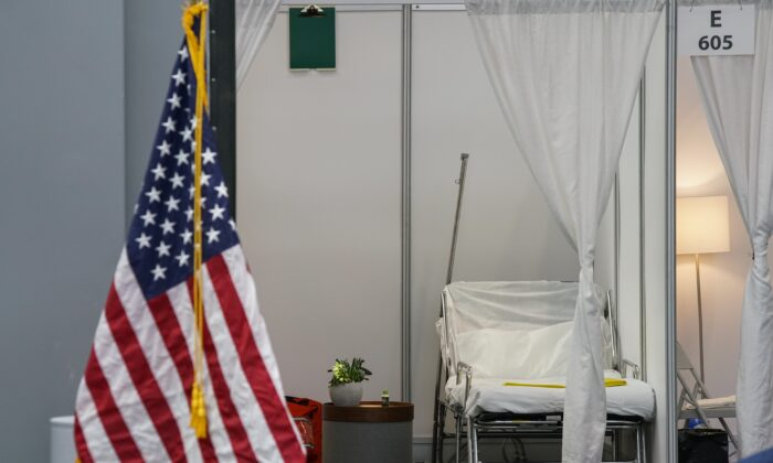 An improvised hospital room is seen during a daily coronavirus press conference by New York Gov Andrew Cuomo at the Jacob K. Javits Convention Center, which is being turned into a hospital to help fight coronavirus cases in New York City on March 27, 2020.  (åMunoz Alvarez/Getty Images)