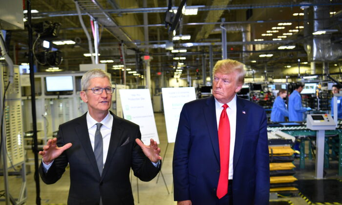 President Donald Trump and Apple CEO Tim Cook speak to the press during a tour of the Flextronics computer manufacturing facility where Apple's Mac Pros are assembled in Austin, Texas, on Nov. 20, 2019. (Mandel Ngan/AFP via Getty Images)