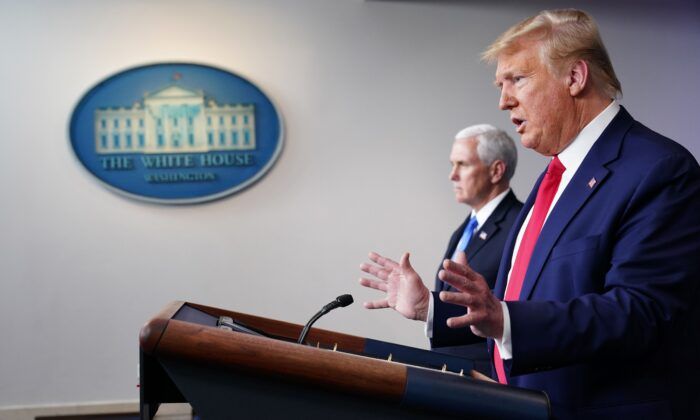 President Donald Trump flanked by Vice President Mike Pence speaks during the daily briefing on the CCP virus in the Brady Briefing Room at the White House in Washington on April 6, 2020. (Mandel Ngan/AFP via Getty Images)