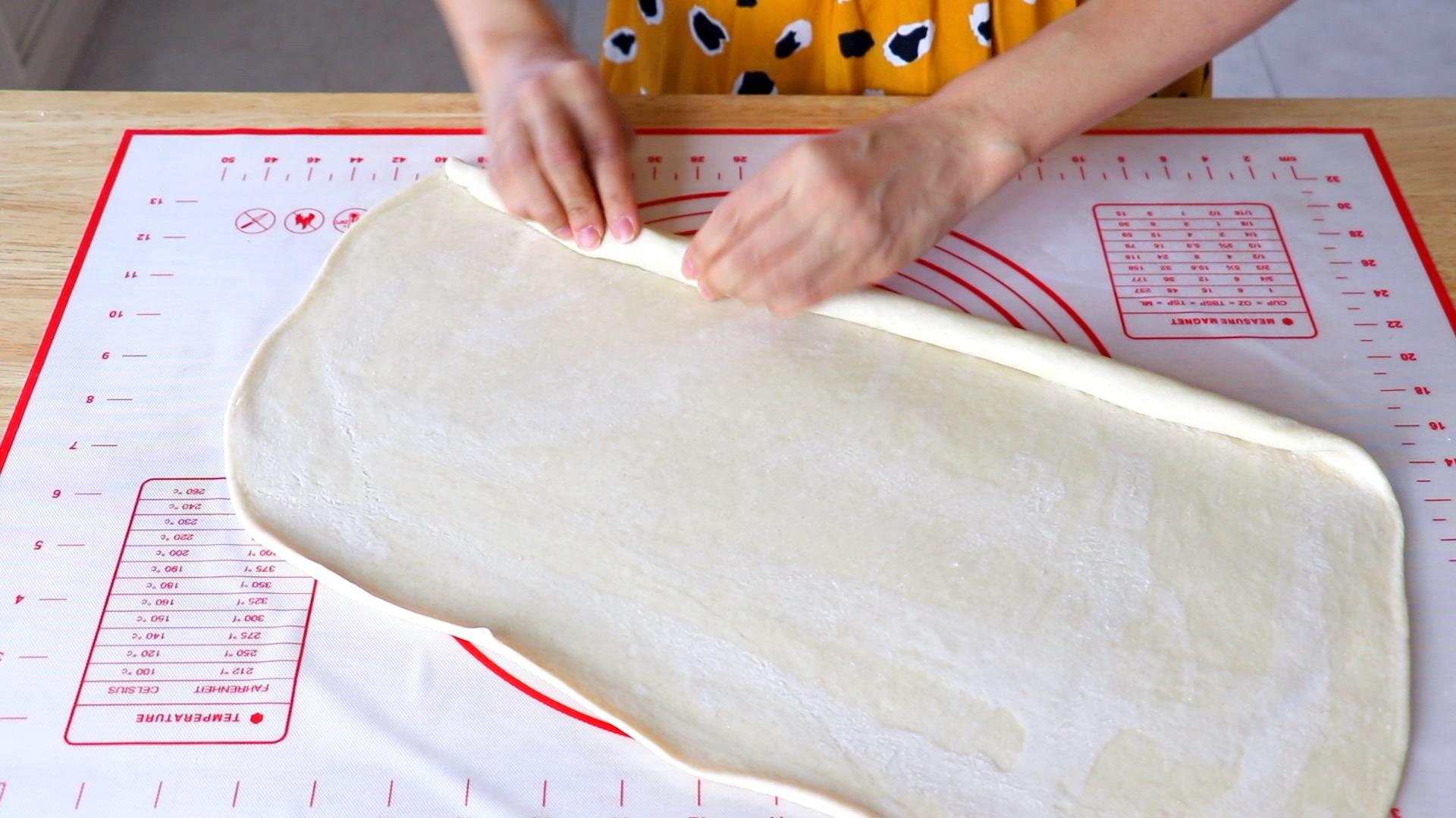 rolling dough into log