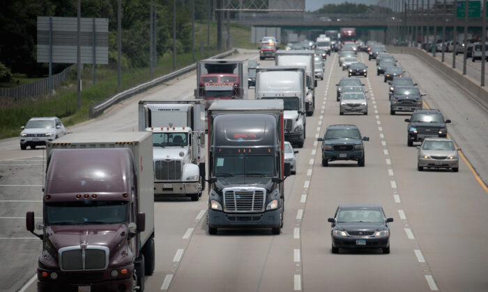 Semi-trucks travel along I-94 near Lake Forest, Ill., on June 21, 2019. (Scott Olson/Getty Images)