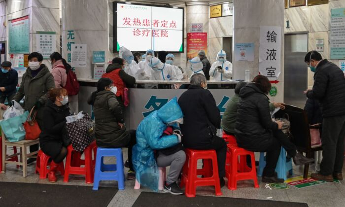 Patients wait for treatment at Wuhan Red Cross Hospital in Wuhan, China on Jan. 24, 2020. (Hector Retamal/AFP via Getty Images)