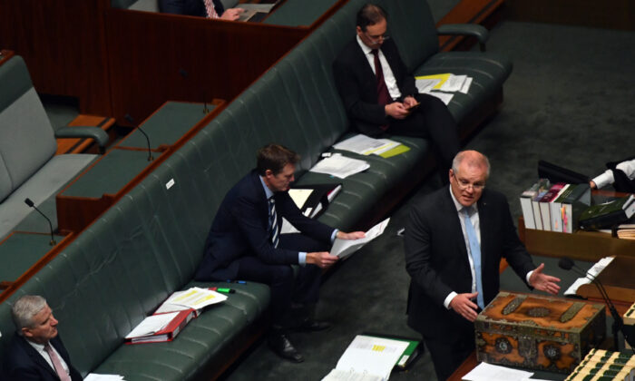 CANBERRA, AUSTRALIA - APRIL 08: Prime Minister Scott Morrison speaks at the despatch box during Question Time in the House of Representatives at Parliament House on April 08, 2020 in Canberra, Australia. The government's $130bn AUD Coronavirus Economic Response Bill will be put to parliament today .(Sam Mooy/Getty Images)