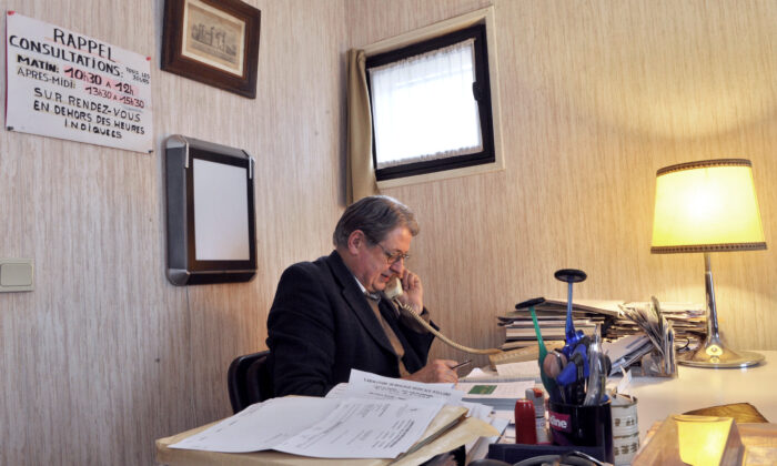 Pierre Brunie a family doctor gives a phone call in his office, on January 29, 2013 in Eglisneuve-d'Entraigue.             (THIERRY ZOCCOLAN/AFP via Getty Images)