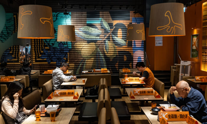 Customers eat in a restaurant with blocked seatings to make sure people adhere to social distancing in Hong Kong, China, on March 29, 2020.  (Anthony Kwan/Getty Images)