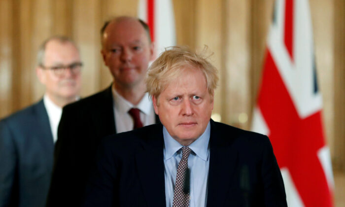 UK Prime Minister Boris Johnson, Chris Whitty, Chief Medical Officer for England and Chief Scientific Adviser to the Government, Sir Patrick Vallance, arrive for a news conference on the CCP virus, in London on March 3, 2020. (Frank Augstein/Pool via Reuters)