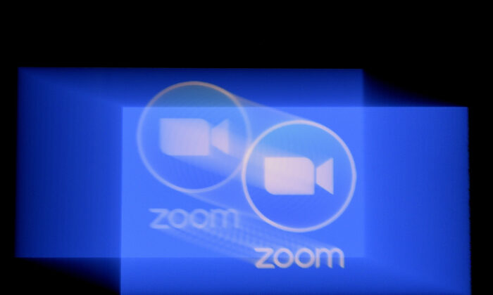 In this photo illustration a Zoom App logo is displayed on a smartphone on March 30, 2020 in Arlington, Virginia. (OLIVIER DOULIERY/AFP via Getty Images)