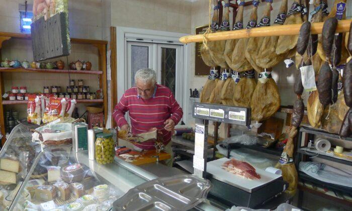 Inside Jamones Pozo, Santiago Pozo Jimenez cuts the jamón. (Ari LeVaux)