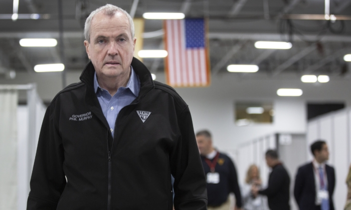 New Jersey Governor Phil Murphy tours an emergency field hospital being prepared at the Meadowlands Expo Center in Secaucus, N.J., on April 2, 2020. (Michael Mancuso/Getty Images)