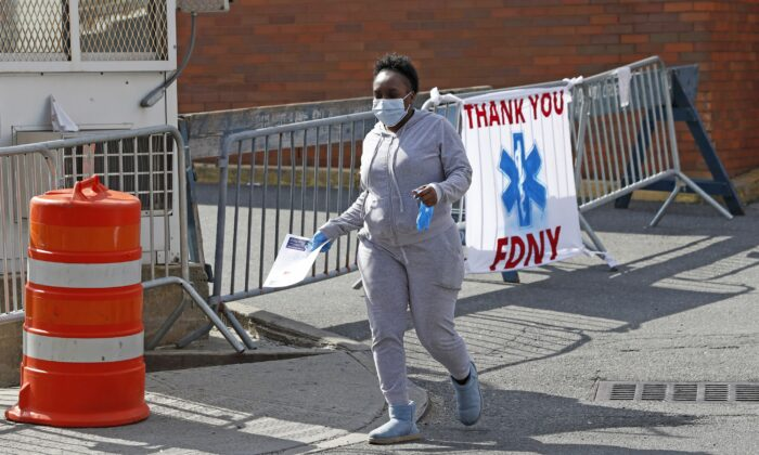A woman leaves Elmhurst Hospital Center after being tested for the CCP virus during the current viral pandemic in the Queens borough of New York on April 7, 2020. (Kathy Willens/AP Photo)