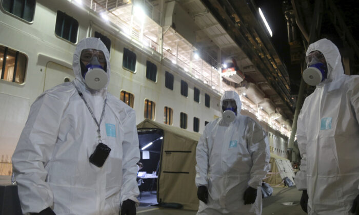 New South Wales Police investigators in protective gear prepare to board the Ruby Princess cruise ship on Wed. April 8, 2020, at Wollongong, Australia. (Nathan Patterson/NSW Police via AP)