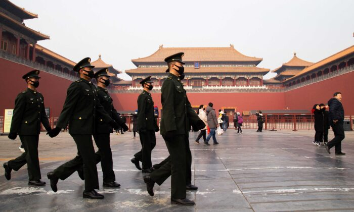 Chinese police officers walk in front of the gated entrance of The Palace Museum in Beijing, China, on Jan. 26, 2020. (Betsy Joles/Getty Images)