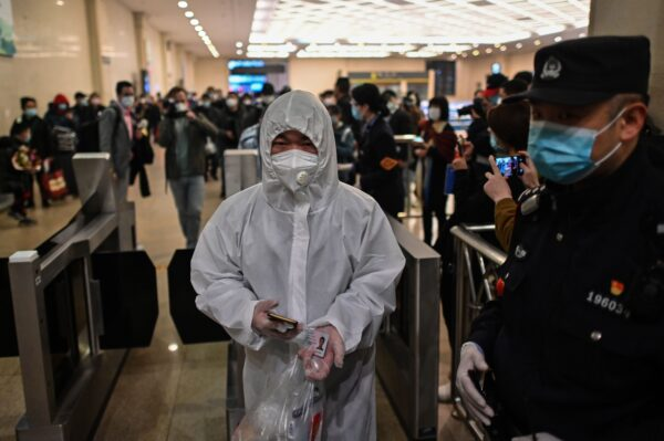A man arrives at Hankou Railway Station in Wuhan