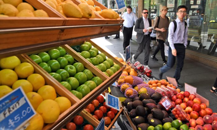 People walk past a fruit stall in Sydney's central business district on November 29, 2016.        (WILLIAM WEST/AFP via Getty Images)