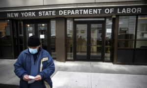 Extra $600 in Virus Unemployment Aid May End a Week Early for Some Americans