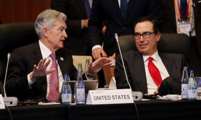 Federal Reserve Chairman Jerome Powell (L) talks with Treasury Secretary Steven Mnuchin during a G20 meeting in Fukuoka, Japan, on June 8, 2019. (Kim Kyung-Hoon/AFP/Getty Images)