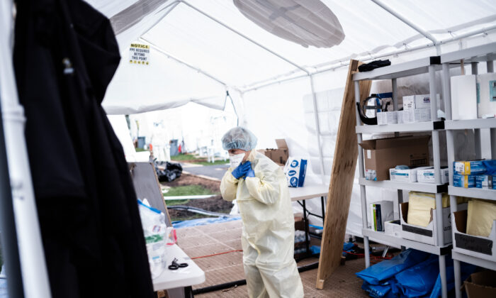 Medical workers putting on equipment at the beginning of their shift at the emergency field hospital run by Samaritan's Purse and Mount Sinai Health System in Central Park in New York City on April 8, 2020. (Misha Friedman/Getty Images)