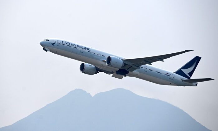 A Cathay Pacific passenger plane takes off from Hong Kong's international airport on March 13, 2019. (ANTHONY WALLACE/AFP/Getty Images)