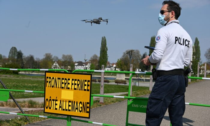 On the 24th day of a strict lockdown in France to stop the spread of COVID-19, a French policeman uses a drone to check the surroundings of the closed German-French border in Strasbourg, eastern France, on April 9, 2020.  (Frederick Florin / AFP via Getty Images)