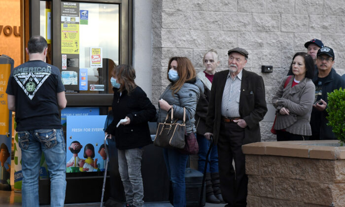 People wait in line to enter a Smith's Food & Drug store in Las Vegas, Nev., on March 20, 2020. (Ethan Miller/Getty Images)