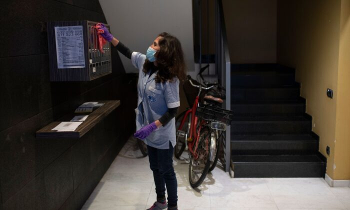 Cecilia Alvarez Velasco, 47, from Ecuador, works cleaning a condominium residence in Barcelona, Spain, on April 9, 2020. (Josep Lago/AFP via Getty Images)