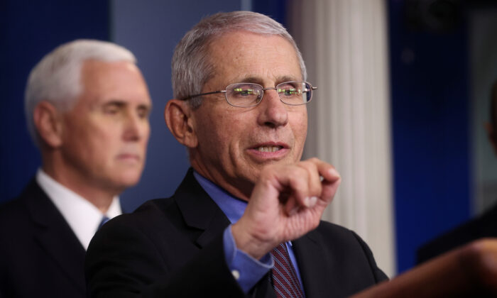 National Institute of Allergy and Infectious Diseases Director Dr. Anthony Fauci answers a question during the daily CCP virus task force briefing as Vice President Mike Pence listens at the White House in Washington on April 9, 2020. (Reuters/Jonathan Ernst)