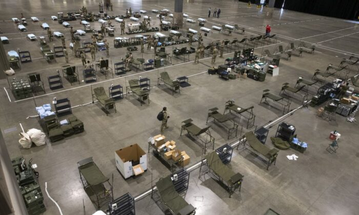 Military personnel set up the 627th Hospital Center field hospital at CenturyLink Event Center in Seattle, Washington on March 31, 2020. (Karen Ducey/Getty Images)