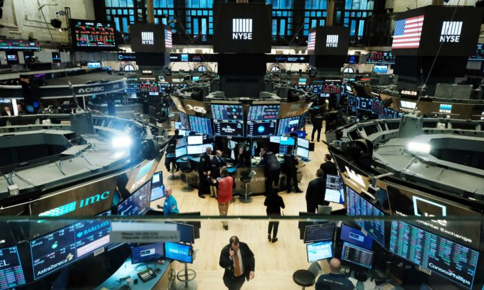 Traders work on the floor of the New York Stock Exchange (NYSE) in New York City on March 20, 2020. (Spencer Platt/Getty Images)