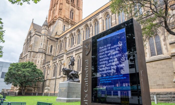 A notice at St. Pauls Cathedral in Melbourne, Australia, on Easter Friday informs patrons of a March 23, 2020, directive by the Australian Government that places of worship must remain closed over the Easter Holidays. (Asanka Ratnayake/Getty Images)