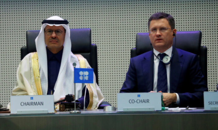 Saudi Arabia's Minister of Energy Prince Abdulaziz bin Salman Al-Saud and Russia's Energy Minister Alexander Novak are seen at the beginning of an OPEC and Non-OPEC meeting in Vienna on Dec. 6, 2019. (Leonhard Foeger/Reuters)