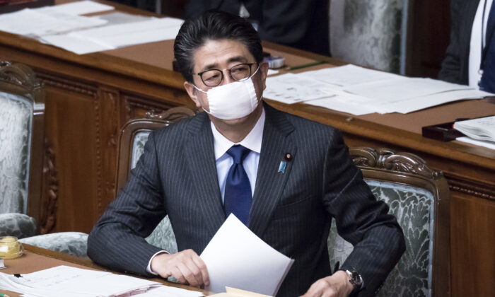 Japan's Prime Minister Shinzo Abe wearing a mask attends an ordinary session at the upper house of parliament in Tokyo on April 2, 2020. (Tomohiro Ohsumi/Getty Images)