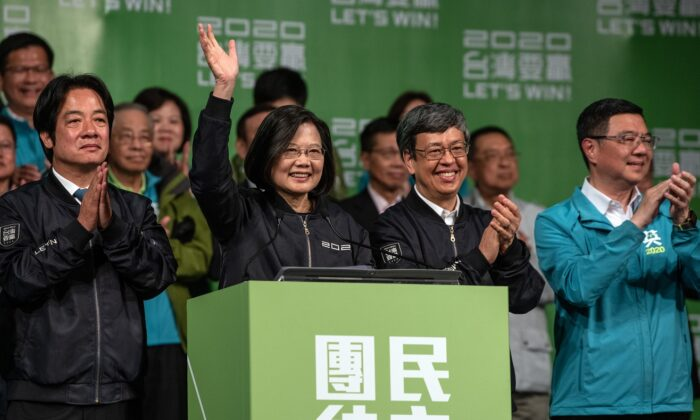 Tsai Ing-wen (C) waves as she addresses supporters following her reelection as President of Taiwan in Taipei on Jan. 11, 2020. (Carl Court/Getty Images)