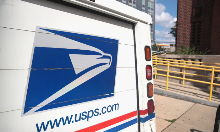 A U.S. Postal Service (USPS) truck leaves a postal facility in Chicago, Ill., on Aug. 15, 2019. (Scott Olson/Getty Images)