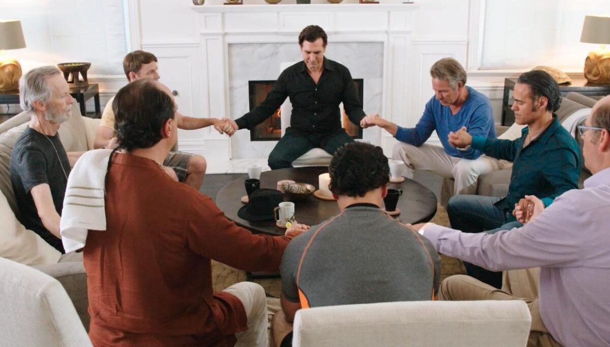 """men holding hands in a circle, in """"Welcome to the Men's Group"""""""