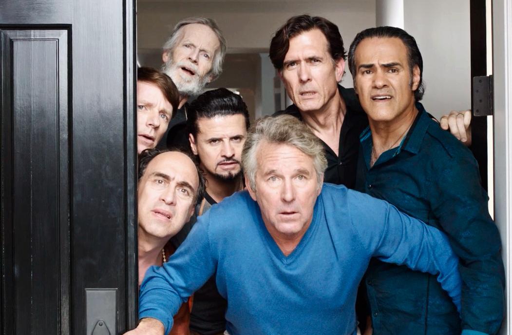 """7 men jammed in a doorway in """"Welcome to the Men's Group"""""""