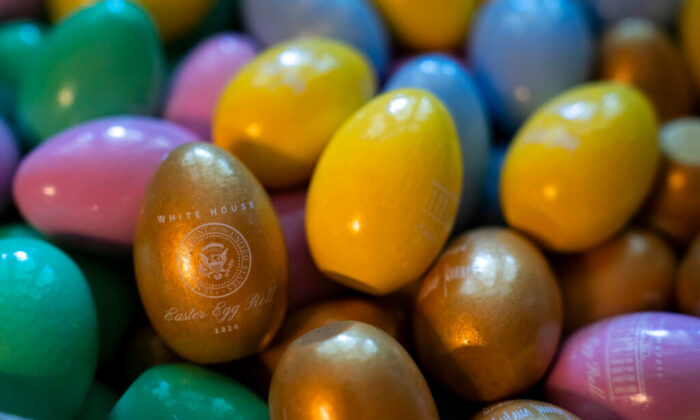 Wooden Easter eggs sit in a box. (Evan Vucci/AP Photo)