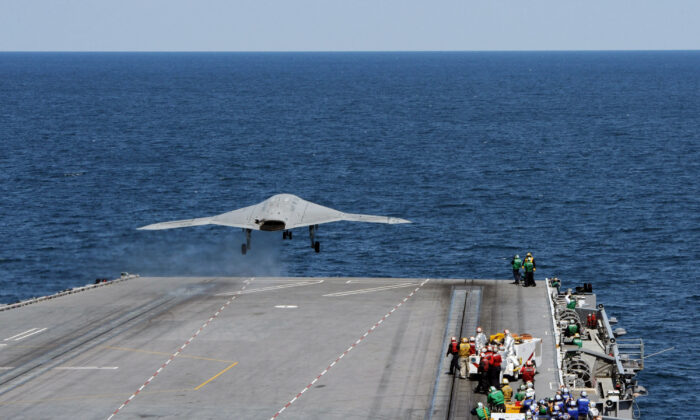 An X-47B Unmanned Combat Air System (UCAS) demonstrator launches from the flight deck of the aircraft carrier USS George H.W. Bush (CVN 77) on May 14, 2013. (U.S. Navy via Getty Images)
